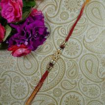Golden Bead Flower Rakhi: