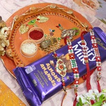 Red Beads Rakhi 4 With Dairy Milk Mixed Dry Fruits Thali: