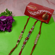 Trendy Rakhi Set Of Three With Lindt Lindor: Send Rakhi to Calgary