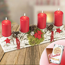 Red Christmas Wreath on a tree trunk with Merci: Christmas Gifts to Germany