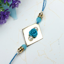 Blue Rose with Pearl Rakhi OMA: Send Rakhi to Oman