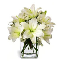 Casablanca Lilies in Vase: Christmas Gifts to Singapore