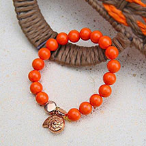 Alluring Orange Beaded Rakhi: UAE/Dubai Rakhi Delivery