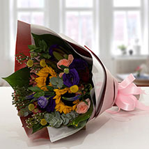 Gracious Flower Bouquet In Paper Packing: Send Flowers and Cakes to UAE