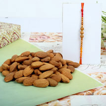 Almond nuts with Sandal Rakhi: Rakhi With Dryfruits UK