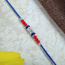American Dianon with Blue Rakhi thread: Send Rakhi to Manchester UK