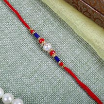 Elegant Red blue Rakhi: Send Rakhi to Manchester UK