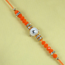 Fancy Orange Diamond Rakhi: Send Rakhi to Cambridge