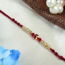 Sparkline maroon fancy thread: Send Rakhi for Brother in Uk