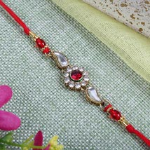 Sparkling Red Diamond bracelet: Send Rakhi to Manchester UK