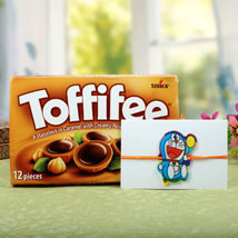 Toffiee with Cartton Doraemon Rakhi: Send Rakhi to Manchester UK
