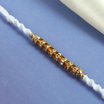 White Fancy Diamon Rakhi: Send Rakhi to Cambridge