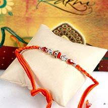 Glittering Maroon Rakhi Thread: Send Rakhi to Irvine