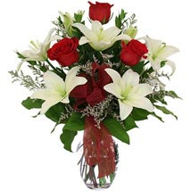 While lilies and roses in Vase: Roses
